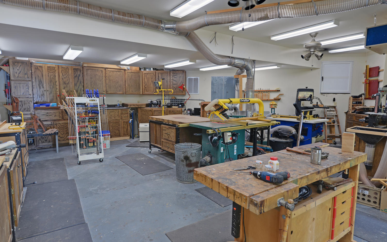 CUSTOM LAKE HOME-large-030-30-Lower Level Workshop-1500x938-72dpi