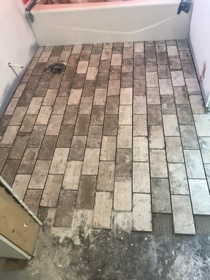 6-tile flooring going down