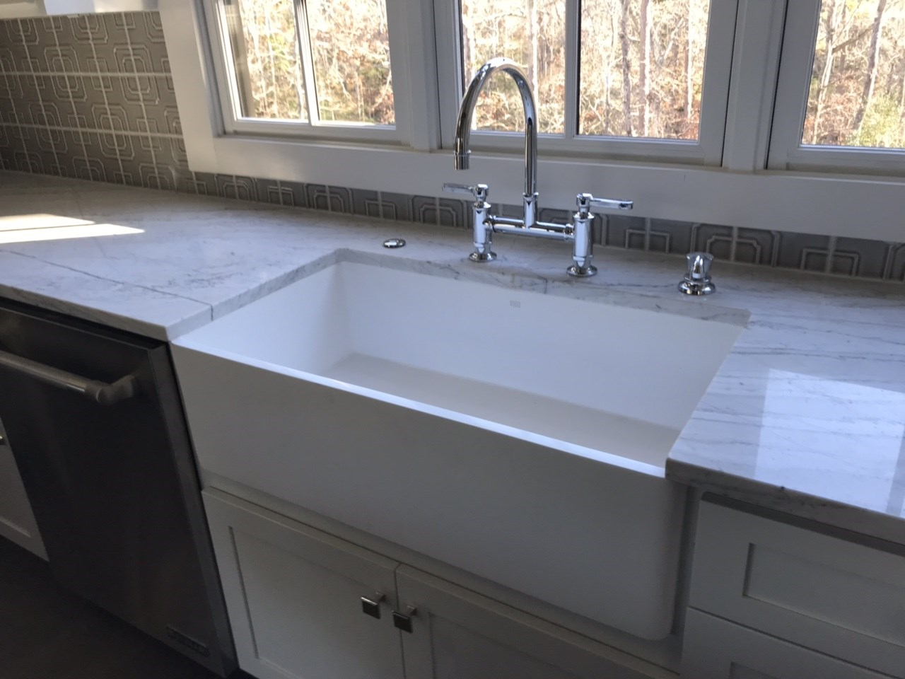 8-apron sink with bridge faucet